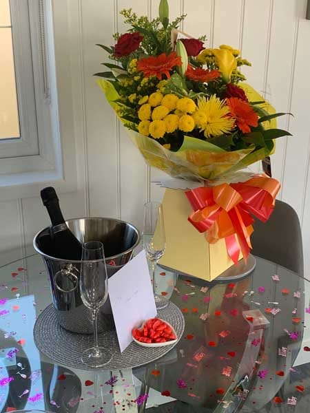 Welcome flowers and fizz